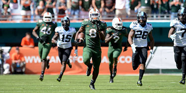 Duke Johnson runs past UNC defenders
