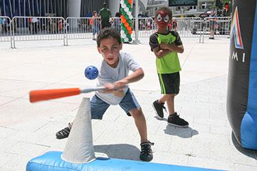 Boy hitting ball off a tee