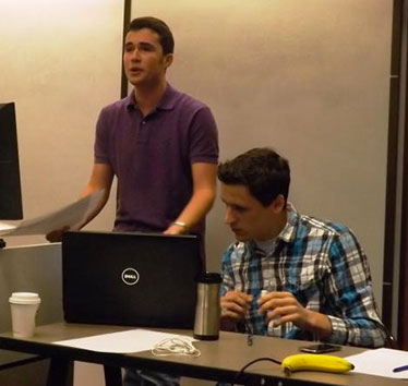 Debaters David Silverman, left, and Spencer George, right
