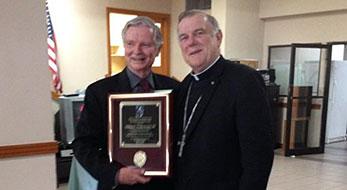 Dean VanderWyden with Archbishop Thomas Wenski