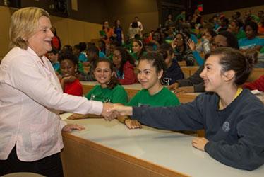 Ileana Ros-Lehtinen shakes a students hand