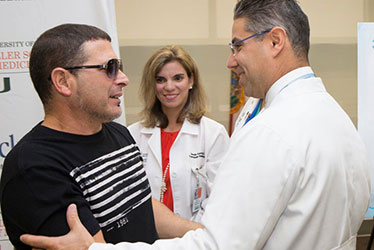 Donor Omar Figueroa, left, with Giselle Guerra, M.D., and Michael Goldstein, M.D.