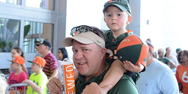 Father and Son in UM Gear