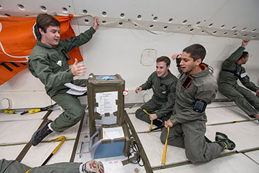 College of Engineering students experiencing weightlessness