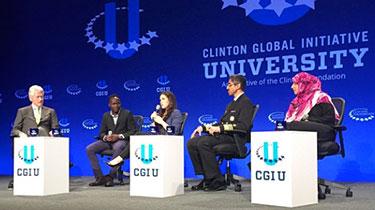 President Clinton moderates the panel