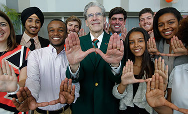 Dr. Julio Frenk with students