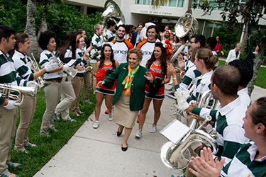 Donna E. Shalala and students